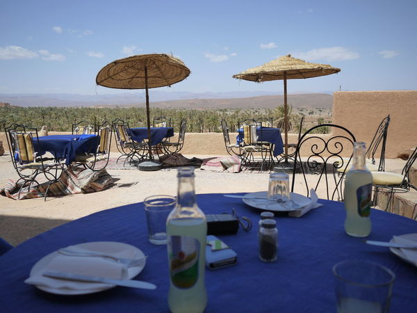 Al Fresco Blue Table Chair Desert Dining Out Empty Restaurant Outdoor Dining  Palm Trees Restaurant Shade Table Tourism Vacation Vacations
