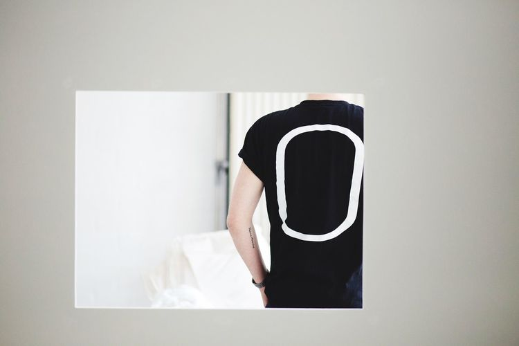 Indoors  One Person Real People Day Young Adult Typography White Background White Window Inked Tattoo Black Shirt