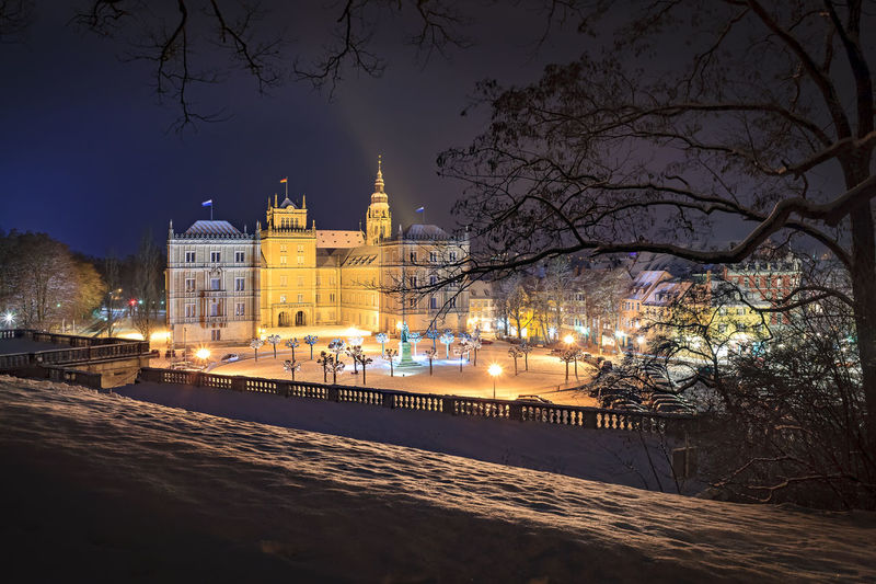 Wintry view of Ehrenburg palace at night in Coburg, Germany Ehrenburg Palace, Lamp, Architecture, Building, Church, Cities, Coburg, Culture, Destinations, Europe, European, Germany, House, Light, Lighting, Night, Snow, Street, Travel, Winter, Wintry Architecture Bare Tree Branch Building Exterior Built Structure City Cold Temperature Illuminated Nature Night No People Outdoors Sky Snow Travel Destinations Tree Water Winter