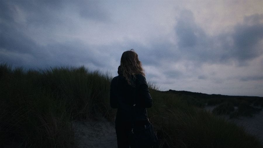 Where do we go? Dark EyeEm Selects Lonely Moody Sky The Week On EyeEm Beach Beauty In Nature Cloud - Sky Darkness And Light Grass Leica Leicacamera Mood Moody Nature One Person Outdoors People Scenics Sky Sunset Wind Women