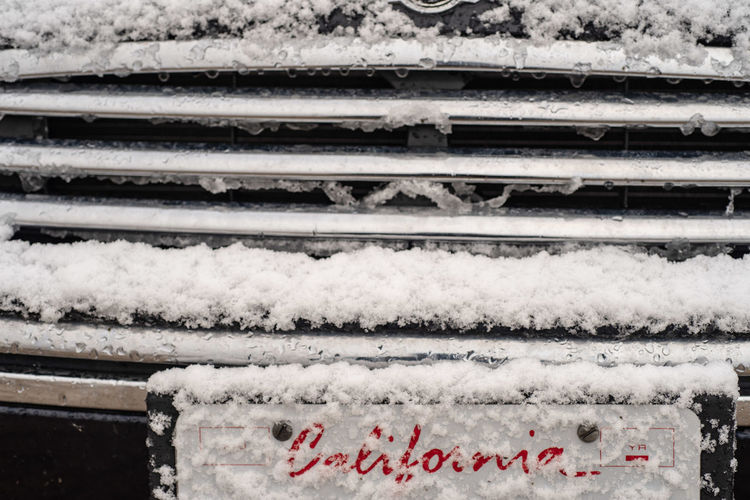 red lettering of the word California on car license plate visible through new fallen snow in morning on car grill front in California, USA License Plate California California Snow Cold Temperature Winter Snow Day No People White Color Outdoors Architecture Nature Frozen Communication Close-up Covering Snowing Car Grill Car License Plate Snow Covered Cold Winter ❄⛄ Lettering Seasons Weather Condition
