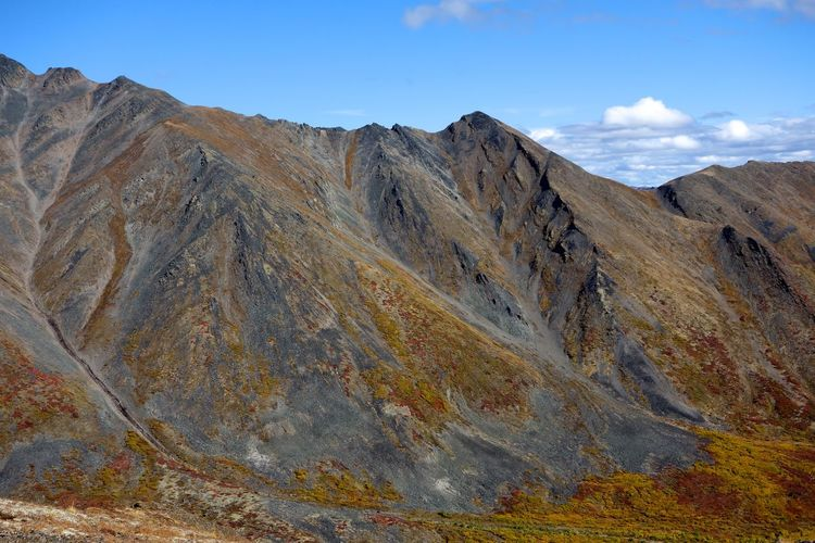 Day Fossil Hiking Landscape Mountain Mountain Ridge Multi Colored Nature No People Outdoors Scenics Tombstone Territorial Park