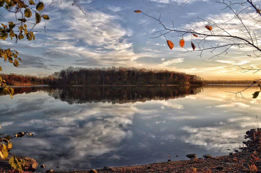 Montreal's glimpse of beauty, before today's snowfall! What a difference a day makes. 🌞🍁🍂👉🏼🌬🌨 Reflection Sky Water Nature Lake Tree No People Tranquility Beauty In Nature Outdoors Scenics Cloud - Sky Travel Destinations Tranquil Scene Day Montréal Moments Beauty In Nature Reflection Lake Taking Photos Capture The Moment December 2016 Sunset #sun #clouds #skylovers #sky #nature #beautifulinnature #naturalbeauty #photography #landscape Popular Photos Thank You My Friends 😊