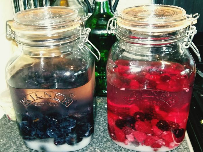 Damson Gin and Raspberry and Blackberry Vodka in Glass Jars  . Featuring Drink Food And Drink Jar Refreshment Drinking Glass Indoors  Fruit Table Freshness No People Food Close-up Day Healthy Eating Alcohol Damson Sugar
