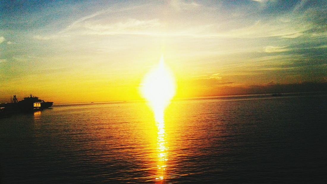 Sunset Reflection Sun Sea Water Nature Dramatic Sky Beauty In Nature Horizon Over Water Sunbeam Gold Colored Sky Outdoors Travel Destinations Sunlight