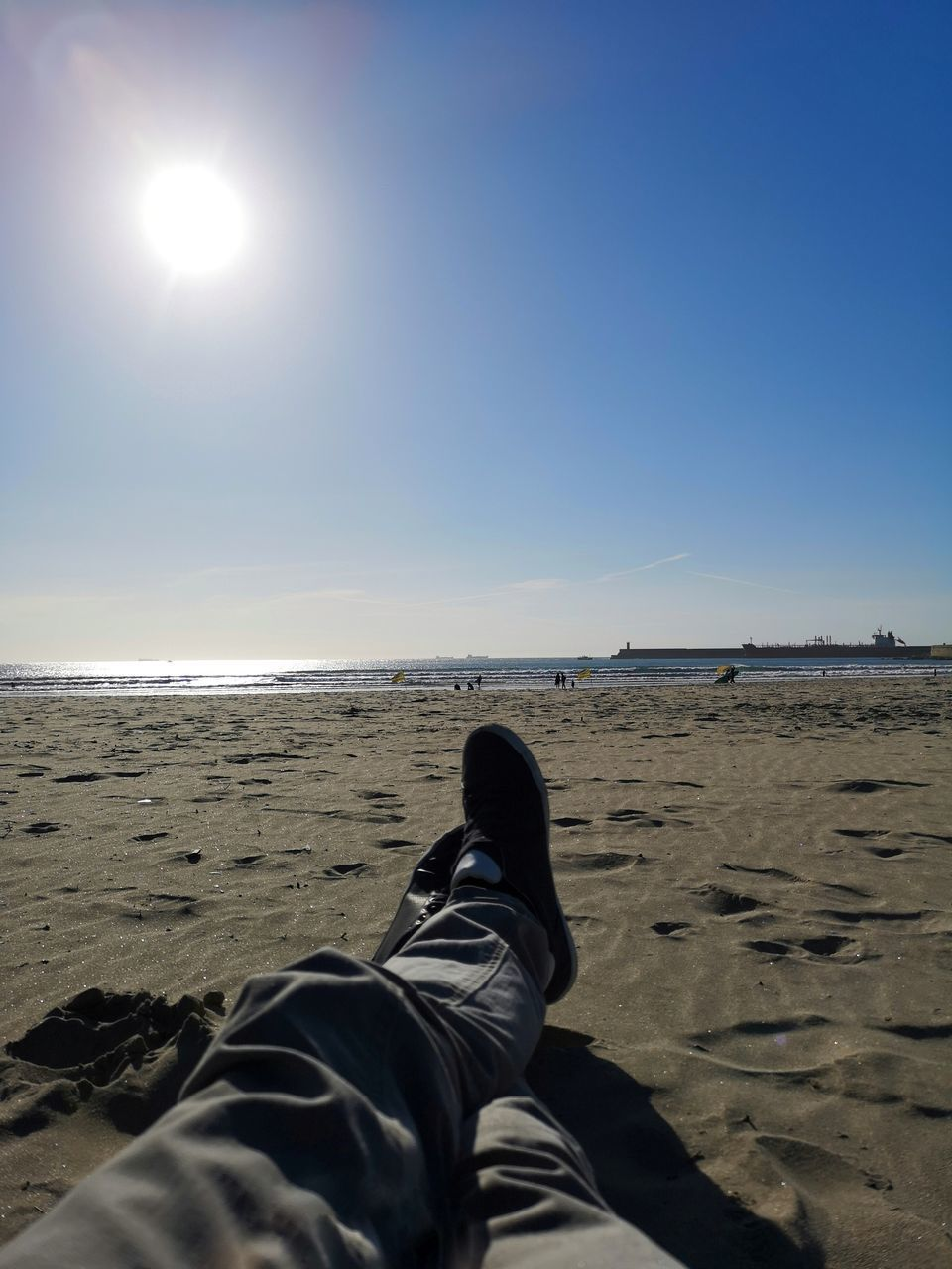 LOW SECTION OF MAN ON BEACH