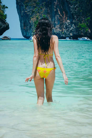 Woman model in a yellow bikini bathing in blue water at Maya Bay, Phi Phi Leh, Thailand Long Legs Maya Beach Swimming Thai Thailand Travel Vacations Beautiful Woman Bikini Fitness Girl Leisure Leisure Activity Lifestyles Model One Person Outdoors Posing Real People Sexygirl Summer Travel Destinations Water Women