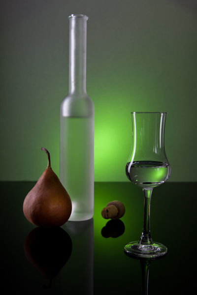 Bottle Colored Background Green Color Studio Shot Social Issues Chemistry Scientific Experiment Wine No People Science Wineglass Close-up Healthy Eating Drinking Glass Alcohol Beaker Winetasting Still Life Schnaps Glas Table Reflection Spiegelung
