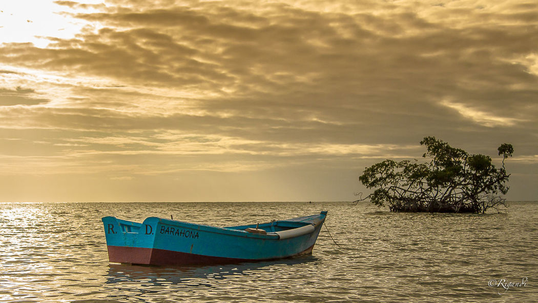 a boat and a small island Beach Beauty In Nature Cloud - Sky Day Horizon Over Water Longtail Boat Mode Of Transport Moored Nature Nautical Vessel No People Outdoors Scenics Sea Sky Sunset Tranquil Scene Tranquility Transportation Tree Water The Great Outdoors - 2017 EyeEm Awards