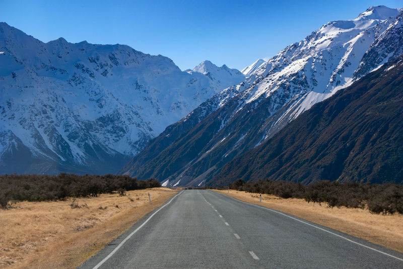 Road leading to Mount Cook National Park Mountain Road Transportation Scenics - Nature Sky Mountain Range Beauty In Nature Landscape Snow No People Direction Nature The Way Forward Environment Tranquil Scene Non-urban Scene Cold Temperature Winter Day Diminishing Perspective Snowcapped Mountain Outdoors Dividing Line