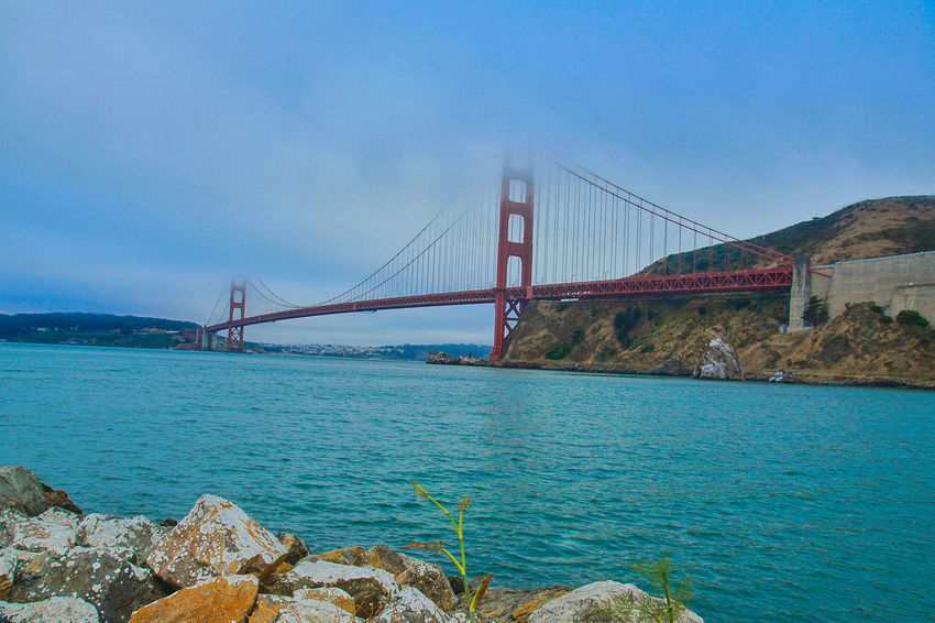 golden gate Bridge - Man Made Structure Connection Suspension Bridge Transportation Water Outdoors Blue Sky Travel Destinations No People Day Built Structure Architecture Sea Nature City