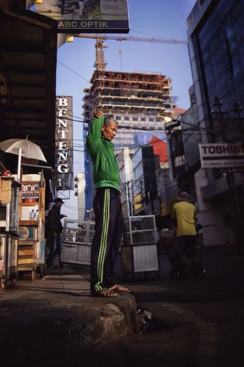 Old man on duty in the morning Streetphotography Street Standing Sporty INDONESIA Morning Light