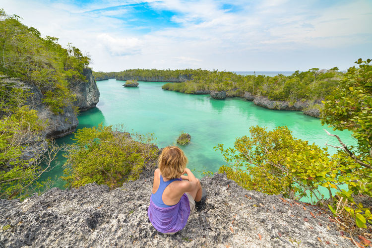 Water One Person Rock Rock - Object Leisure Activity Nature Solid Day Beauty In Nature Childhood Casual Clothing Lifestyles Plant Real People Scenics - Nature Lake Child Sky Rear View Outdoors Hairstyle Looking At View