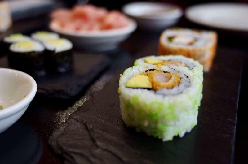 Close-up of sushi served on slate