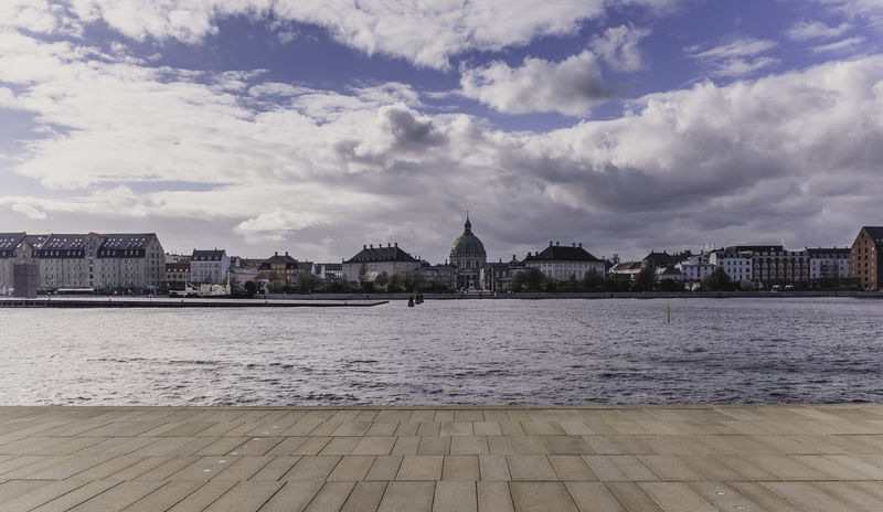 Amalienborg Palace seen from the Royal Theater Copenhagen Amalienborg Amalienborgpalace Architecture Bench Bench Lover  Boat Built Structure City Cityscape Cloud - Sky Copenhagen Harbour Copenhagen Skyline Copenhagen Waterfront River Riverview Ship Ships Travel Destinations Travel Photography View Water