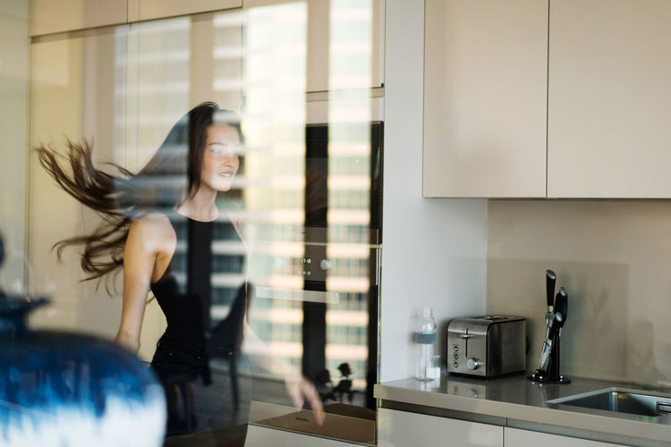Portrait of a beautiful young woman in the kitchen
