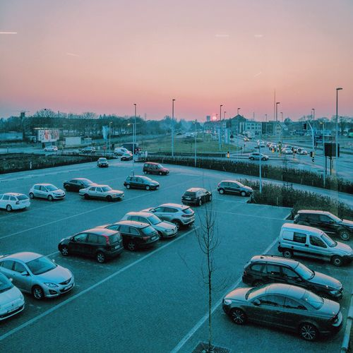 Cars parked at parking lot against sky