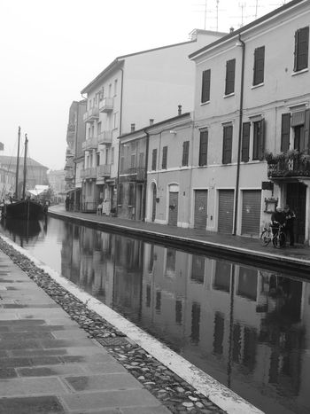 Architecture Blackandwhite Blackandwhite Photography Building Exterior Built Structure Canal Canals And Waterways Canalstreet City City Life Clear Sky Comacchio Comacchiocity Comacchiolidi Comacchiopiccolavenezia Comacchiosagradellanguilla Day Diminishing Perspective Footpath No People Reflection Standing Water The Way Forward Water Waterfront