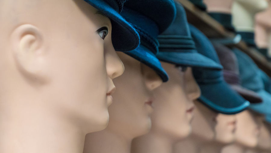 Close-Up Of Mannequin With Caps