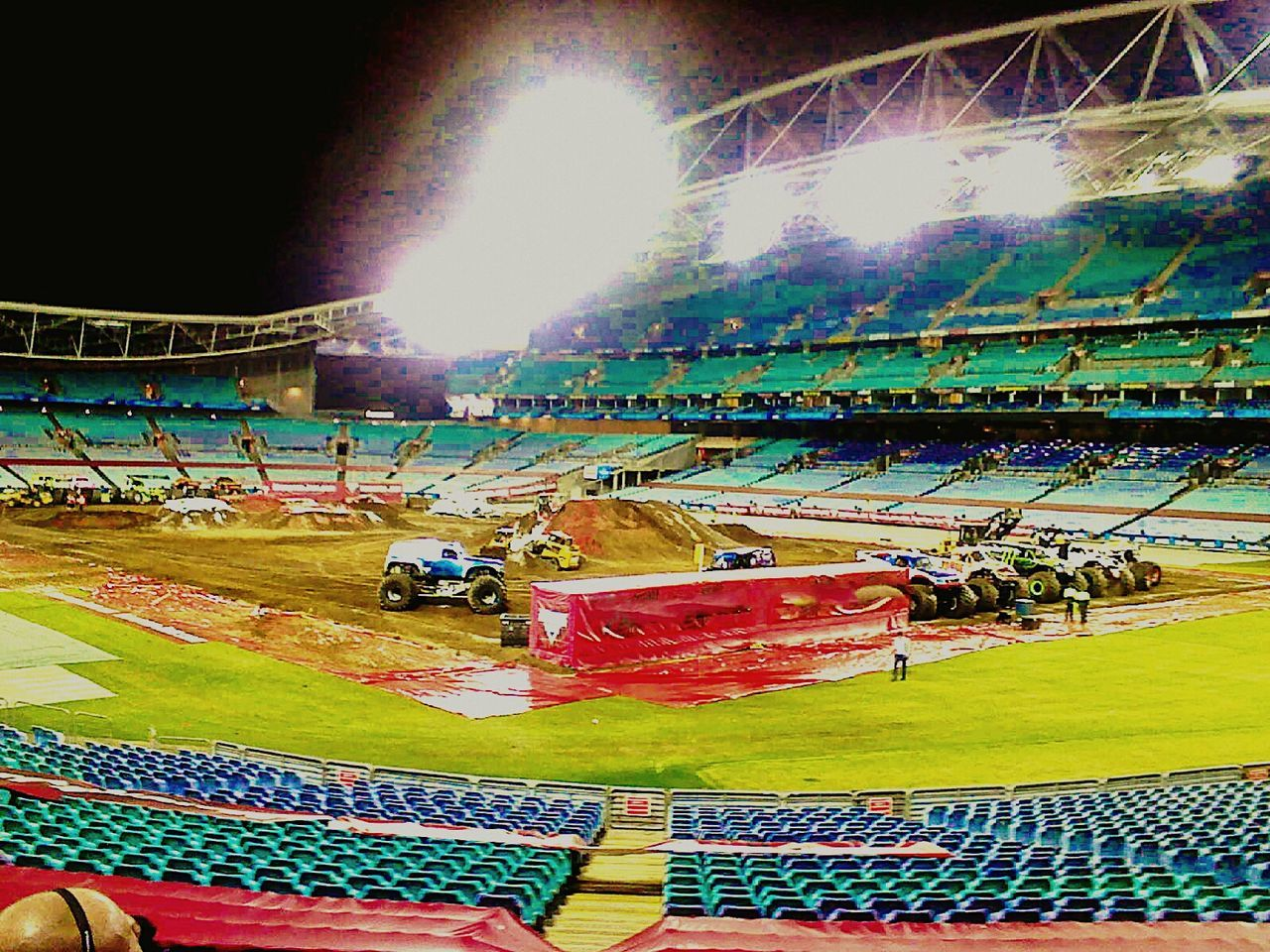 stadium, arts culture and entertainment, crowd, large group of people, sport, outdoors, real people, sports track, motorsport, auto racing, day, fan - enthusiast, sky, people