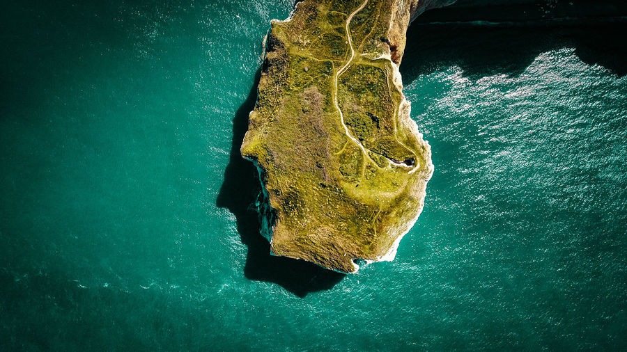 Aerial view of cliff amidst sea