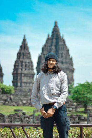 Portrait of man standing against temple