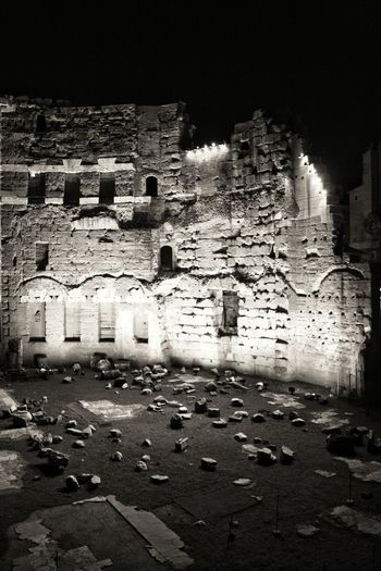 Rocks the city! Building Exterior Architecture Built Structure No People City Outdoors Day Monochrome Photography Holidays Rome, Italy Lights City Roma Architecture History Arts Culture And Entertainment Travel Destinations Silence Antique Stones Relucs Mercati Di Traiano Likeapond Fragility