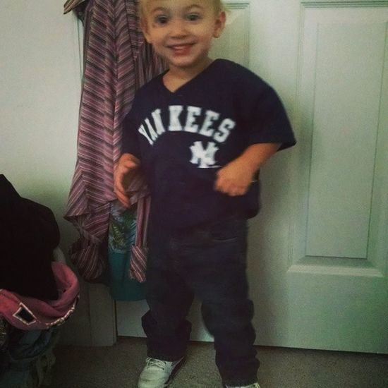 My little man ❤ always reppin Yankees 631 Jordans Grape 5s