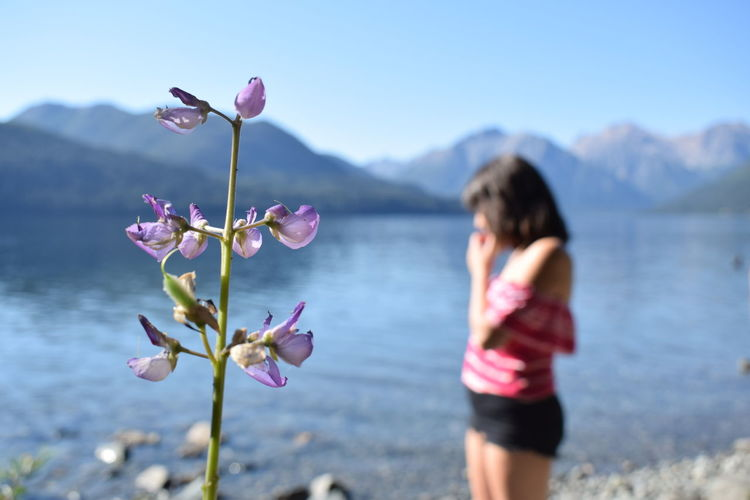 Beauty In Nature Close-up Cordillera Day Flower Focus On Foreground Lake Mountain Nature One Person Outdoors People Pink Color Real People Sky Water Woman