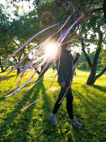 Sunlight Plant Real People Nature Grass One Person Growth Lifestyles Green Color Sunny Lens Flare Sunbeam Shadow Day Leisure Activity Field Tree Beauty In Nature Land Outdoors