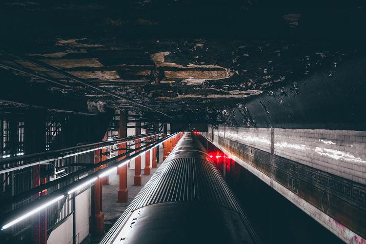 Train at illuminated railroad station