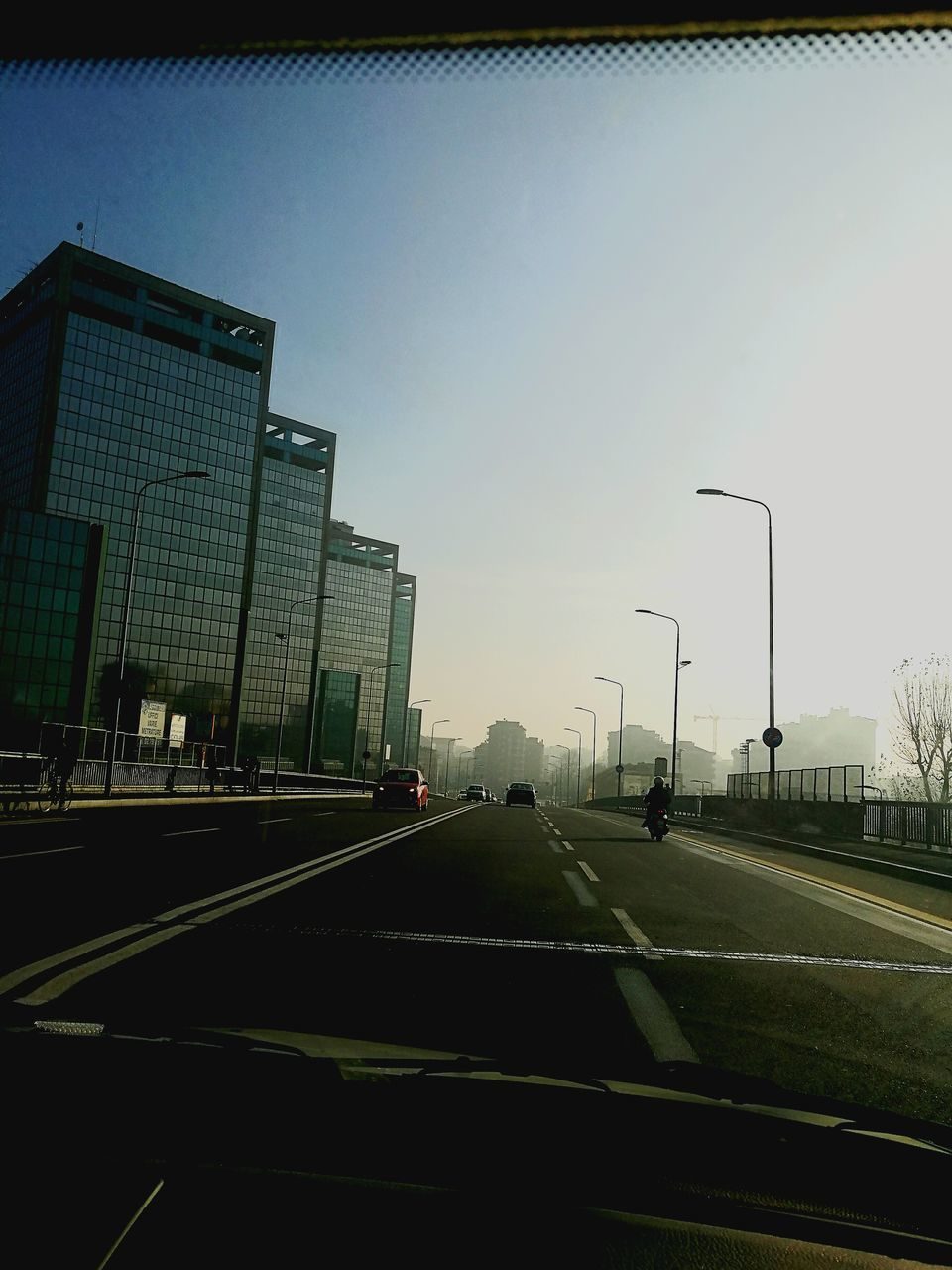 car, transportation, road, land vehicle, mode of transport, city, car interior, the way forward, day, no people, sky, clear sky, outdoors, architecture