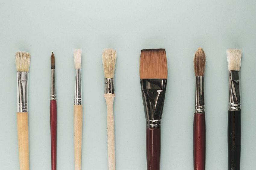 paintbrushes Art And Craft Art And Craft Equipment Brush Choice Close-up Craft Creativity Group Of Objects In A Row Indoors  Make-up Medium Group Of Objects Multi Colored No People Paintbrush Side By Side Still Life Studio Shot Table Variation Wood - Material