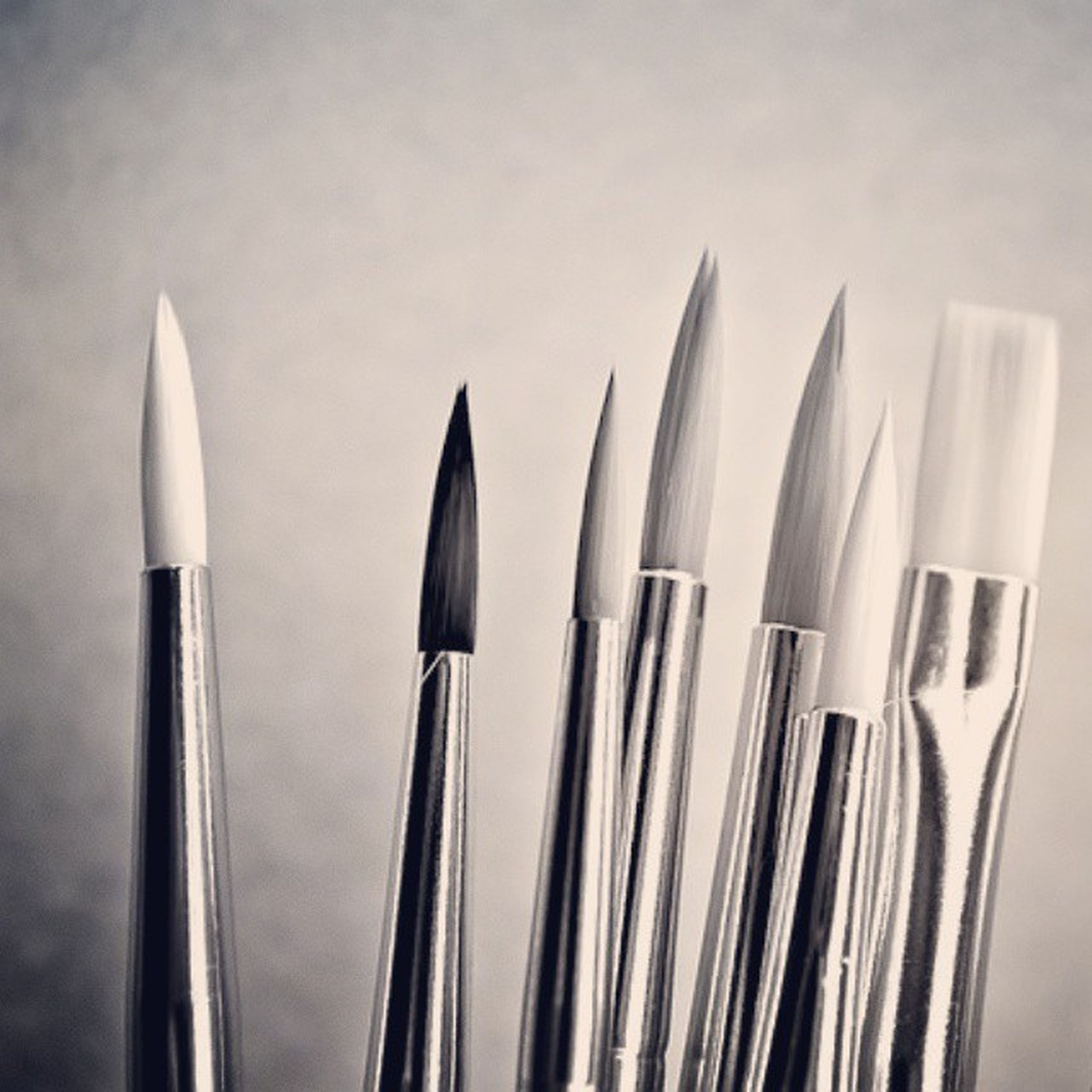 still life, white background, indoors, in a row, studio shot, side by side, close-up, large group of objects, order, arrangement, repetition, variation, no people, white color, group of objects, fork, pencil, metal, medium group of objects, choice