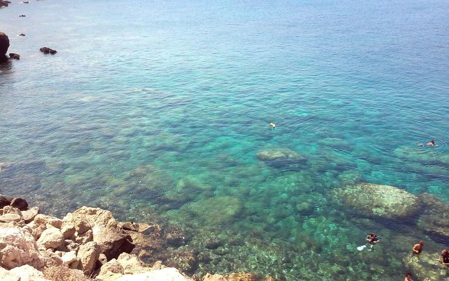 Descovering Places Travel Photography People Swimming Scuba Diving Scuba DiversClear Waters Rocks Swiming Diving Clear Sea Blue Sea Concept