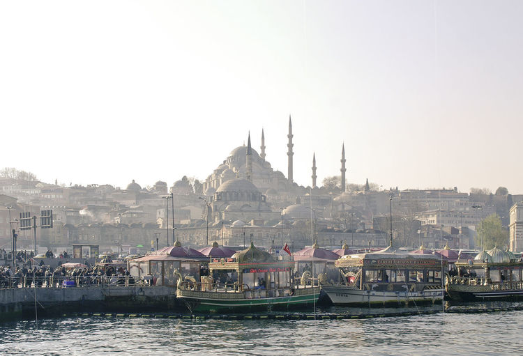Boats At Harbor With Blue Mosque In Background