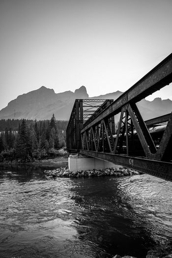 engine bridge in Canmore Blackandwhite Monochrome Country River Mountain Rocky Mountains Water Bridge - Man Made Structure Business Finance And Industry Steel Sky Architecture Built Structure Rail Transportation