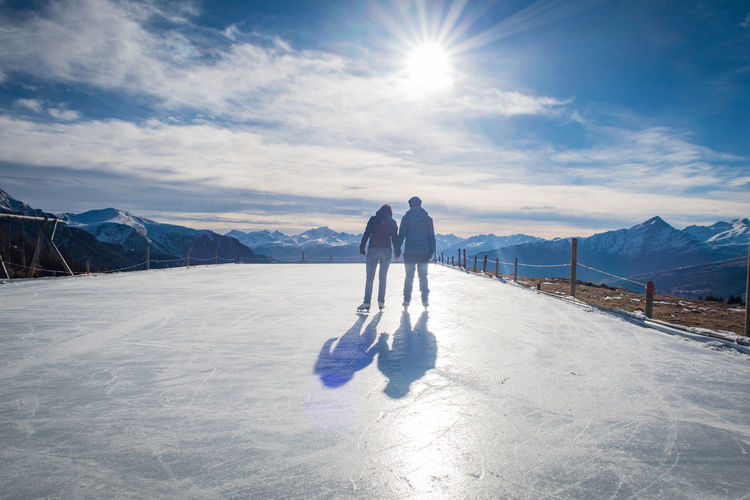 couple skating on an ice field in the swiss mountains in graubünden Couple Graubünden Ice Love Alps Cold Temperature Ice Skate Landscape Leisure Activity Lifestyles Mountain Range Mountains Outdoors Shadows Skating Sky Snow Sun Sunlight Switzerland Two People Winter Lost In The Landscape Be. Ready. See The Light EyeEm Ready   EyeEm Ready   Shades Of Winter #FREIHEITBERLIN