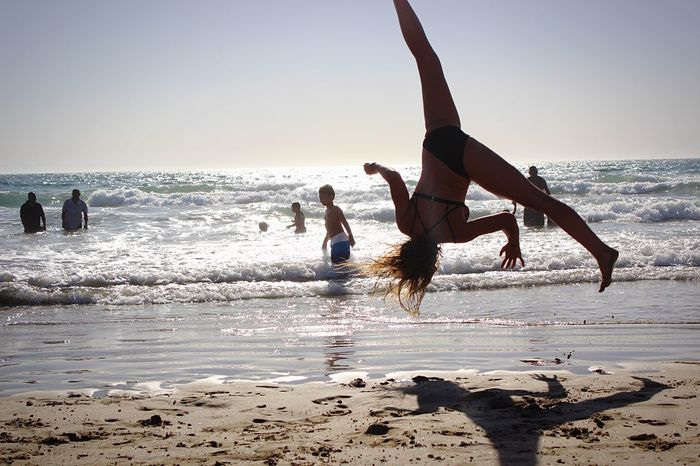 Gymnastics Beauty In Nature Sea Healthy Lifestyle Beach Water Lifestyles Coordination Motion Sky Strength Nature Horizon Over Water Skill  Ariel Beachphotography Beautiful Nature