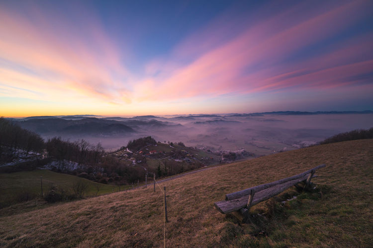 Sunrise from Donačka gora, Slovenia Beauty In Nature Bench Cloud Cold Colorful Dawn Fence Flow  Fog Freezing Grass Hills Landscape Long Exposure Morning Motion Nature No People Outdoors Photography Scenics Sky Slovenia Sunrise Winter