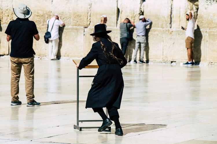 Rear view of people walking on floor