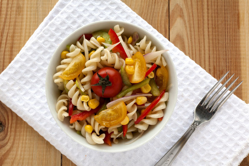 Fusilli salad with yellow and red cherry tomatoes, red and green pepper, sliced onion and corn grains bowl. With fork and white napkin on wooden background. Fusilli Natural Light Salad Spanish Onion Cherry Tomatoes Corn Grain Directly Above Food Food And Drink Fork Freshness Fusilli Pasta Fusilli Salad Green Peppers Healthy Eating Italian Food No People Pasta Pasta Salad Red Peppers Striped Background Studio Photography Summer Salad Tomato Yellow Cherry Tomato