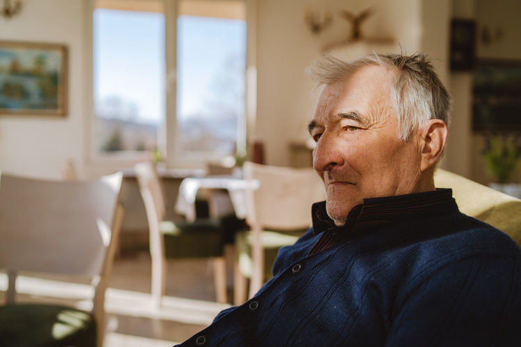 Man sitting on chair at home