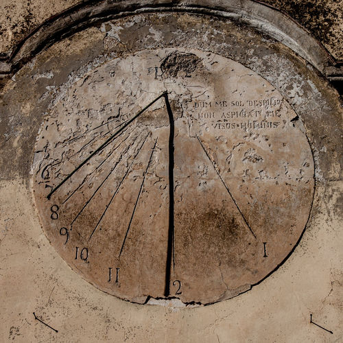 the sundial was used by the ancients to measure time. This was engraved on a stone wall. Antico Sunlight Wall Accient Accient Watch Ancient Civilization Day Meridiana No People Outdoors Stone Sundial Text Time