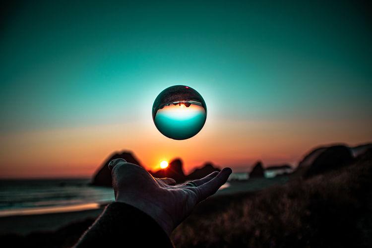 Through my lensball i capture the sun.