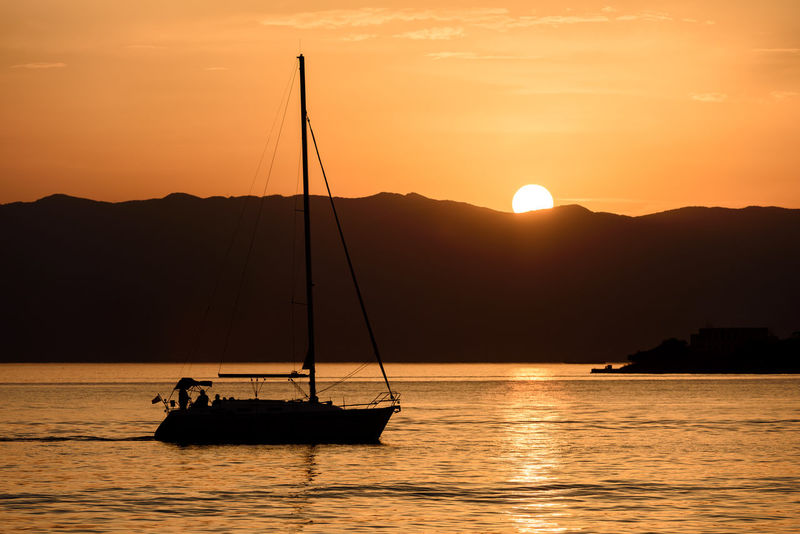 Relaxing Summer Views Summertime Sunset Silhouettes Sunset_collection Tranquility Transportation Travel Travel Photography Beauty In Nature Beauty In Nature Nature Nautical Vessel Ocean Outdoors Relaxing Moments Sailing Scenics Sea Silhouette Summer Sunset Sunsets Tranquil Scene Tranquility
