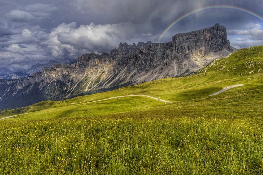 Mountain Landscape Outdoors Grass No People Day Sky San Vito Di Cadore Colle Santa Lucia Passo Giau Travel Destinations Italy Peak Dolomites Mountain Peak HDR Clouds Rainbow Mountain Range Dramatic Sky Panoramic Valley Alps Field Nature