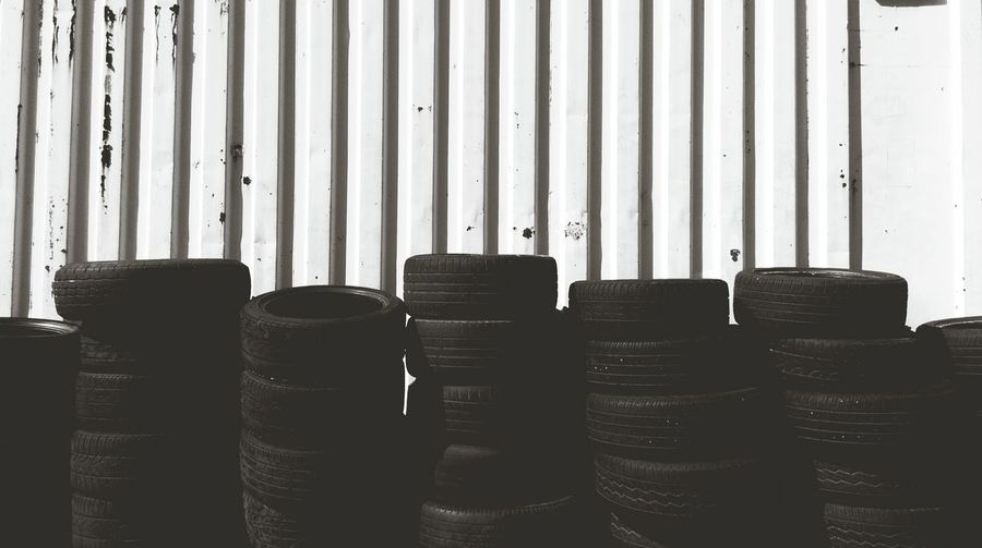 Vehicle tires stacked against wall