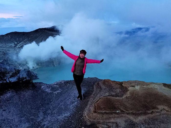 Girl standing on mountain against sky