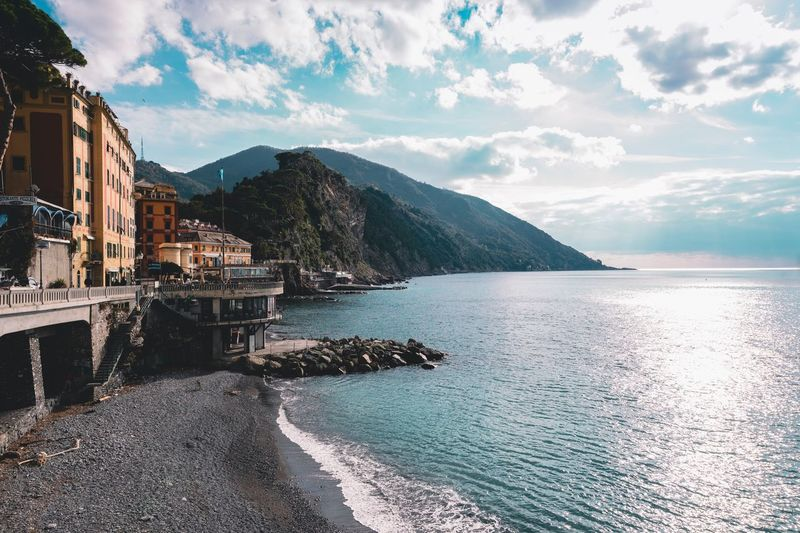 Camogli Water Sky Mountain Cloud - Sky Sea Architecture Built Structure Beach Sunlight Beauty In Nature Tranquil Scene Tranquility Building Reflection Scenics - Nature No People Outdoors Nature Building Exterior Day